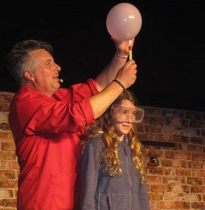 Balloon filled with water over her head at Henley Festival